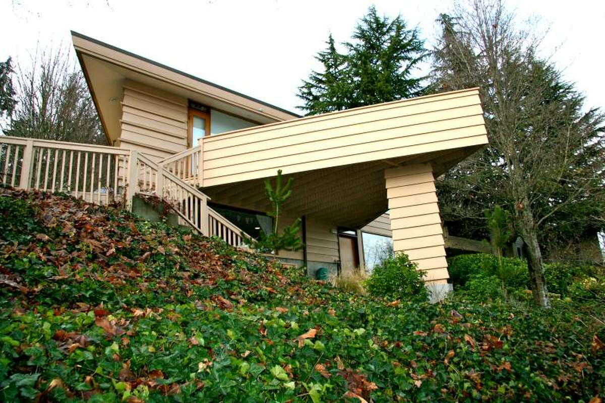 Frank Lloyd Wright disciple Milton Stricker designed this distinctive, diamond-shaped home, built in 1982 at 2274 Lotus Ave. S.W., in West Seattle. The 2,800-square-foot house has three bedrooms, 2.75 bathrooms, two fireplaces, two decks, cedar walls, vaulted ceilings and dramatic views of Elliott Bay, downtown, Mount Rainier and Queen Anne. It sits on a 9,566-square-foot lot and is listed for $824,000. See more about the home here and more on Stricker here and here.