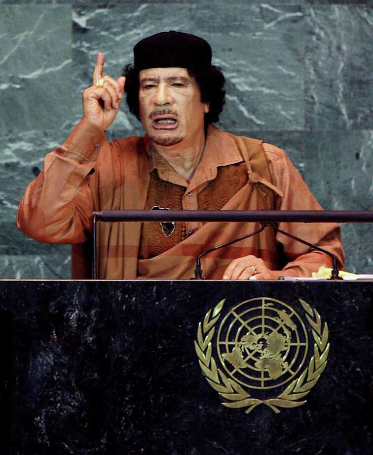 NEW YORK - FILE:  Libyan leader Col. Moammar Gadhafi speaks to the United Nations General Assembly at the U.N. headquarters on September 23, 2009 in New York City.  According to reports October 20, 2011, the former leader of Libya Muammar Gaddafi was killed while fleeing Libyan fighters who had overrun his hometown of Sirte.  (Photo by Rick Gershon/Getty Images) Photo: Rick Gershon / 2009 Getty Images