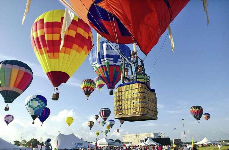 Event: Ballunar Liftoff Festival, Clear Lake, TX Date: Aug. 25-27, 2006 Cutline: Visitors to the RE/MAX Ballunar Liftoff Festival, Aug. 25-27, will get a close-up view of giant, hot-air balloons as they participate in competitions, evening balloon glows and fly across the NASA/Johnson Space Center in Clear Lake. / handout email