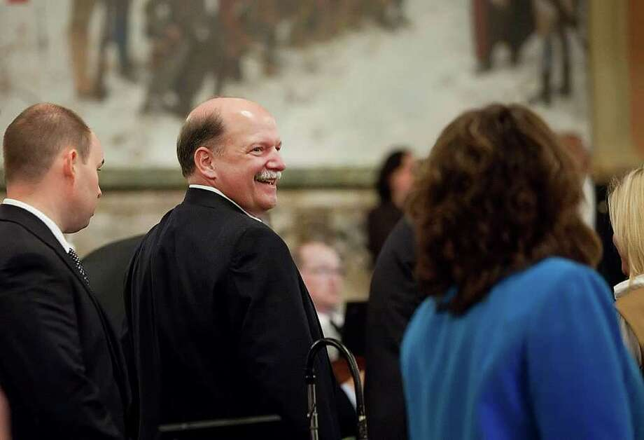 Rep. Glen Grell, R-Cumberland, one of the authors of a bill aimed at giving Pennsylvania Gov. Tom Corbett the power to force Harrisburg, Pa., into a state-sanctioned plan to deal with its staggering debt, smiles after the House voted to send the bill to Corbett, Wednesday, Oct. 19, 2011, in Harrisburg. (AP Photo/The Patriot-News, Christine Baker) Photo: Christine Baker / The Patriot-News