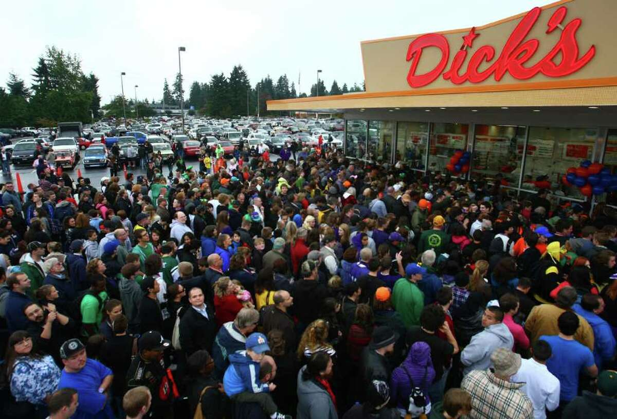 Hundreds of hungry fans wait in line during the grand opening of the Edmonds Dick's Drive-in on Thursday, October 20, 2011. This was the first of new Dick's restaurant in 37 years. The popular hamburger joints are Seattle-area icons.