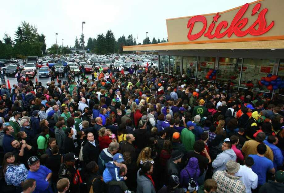 Hundreds of hungry fans wait in line during the grand opening of the Edmonds Dick's Drive-in on Thursday, October 20, 2011. This was the first of new Dick's restaurant in 37 years. The popular hamburger joints are Seattle-area icons. Photo: JOSHUA TRUJILLO / SEATTLEPI.COM