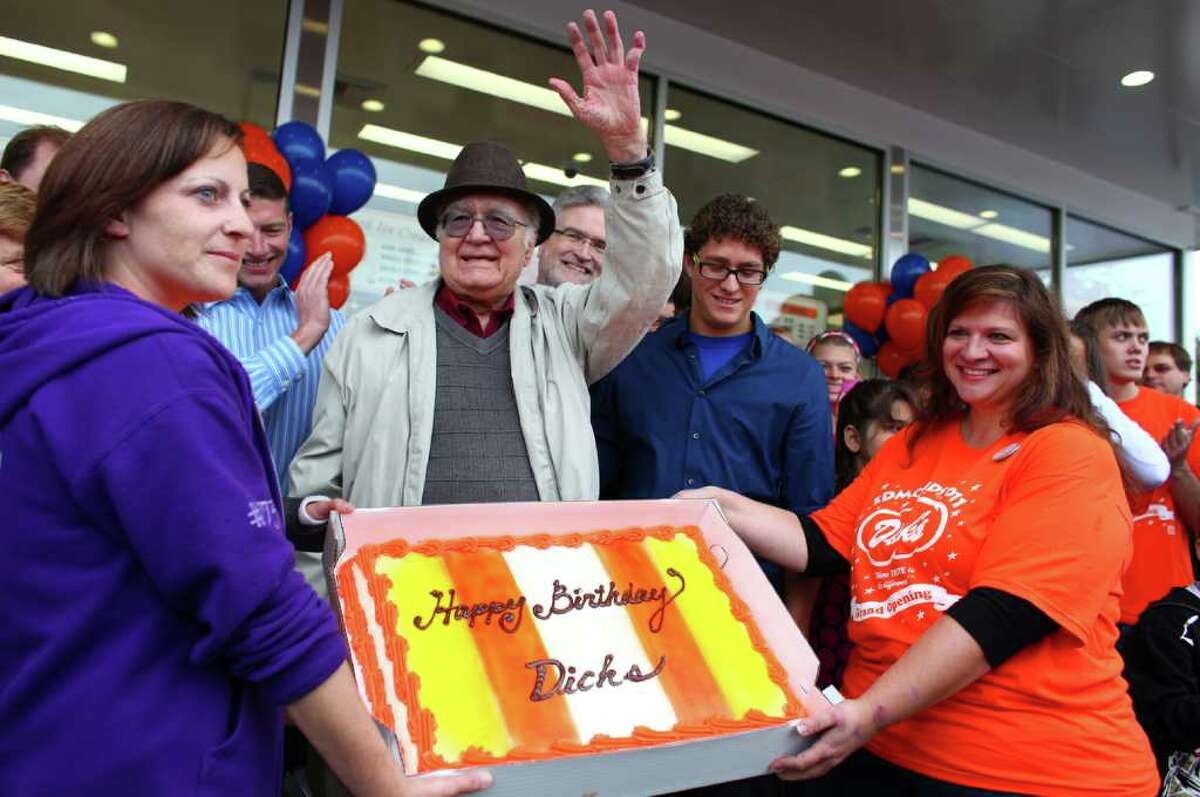 Dick Spady waves to fans as they serenade him days after he turned 88 years-old during the grand opening of the Edmonds Dick's Drive-in. This was the first of new Dick's restaurant in 37 years. The popular hamburger joints are Seattle-area icons.