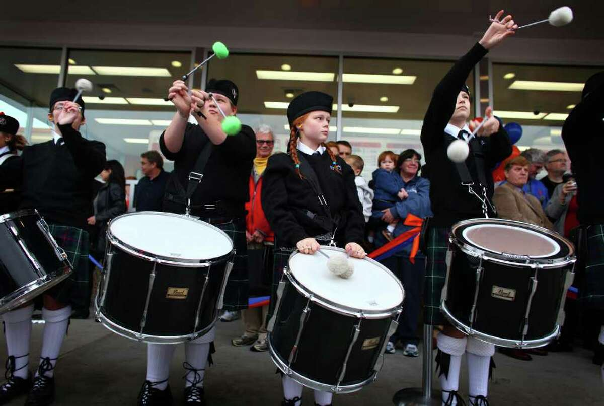 A bagpipe band performs during the grand opening of the Edmonds Dick's Drive-in.