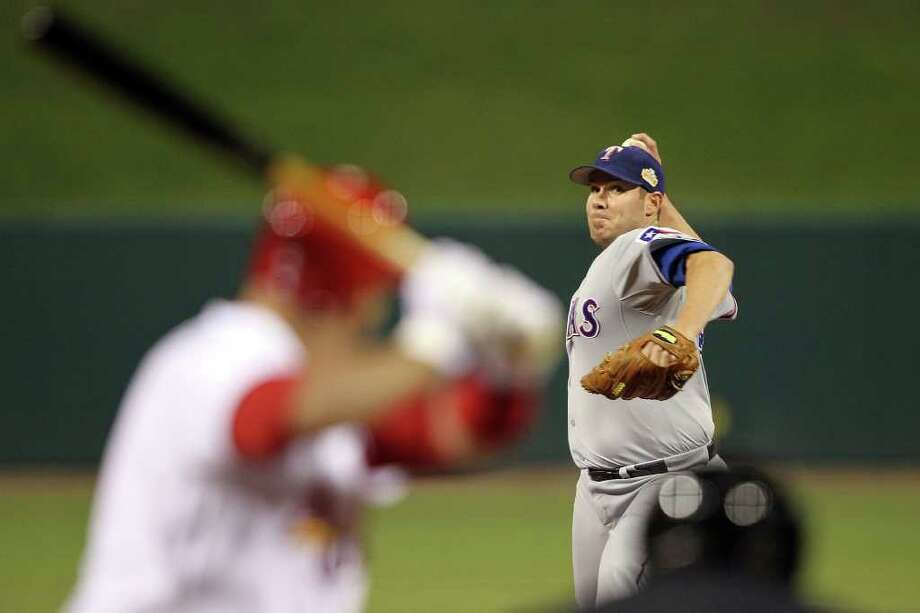 Rangers pitcher Colby Lewis throws in the first inning. Photo: Jamie Squire, Getty / 2011 Getty Images