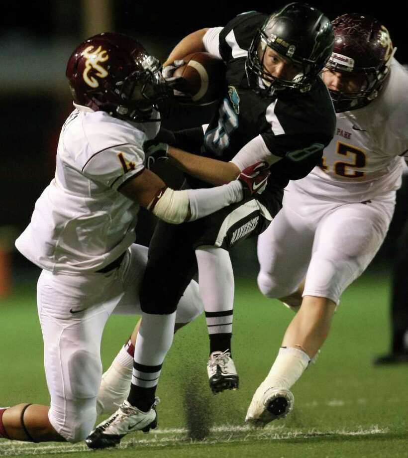 Pasadena Memorial's Chris Cargile (8) is tackled by Deer Park's John Lopez. Photo: Eric Christian Smith, For The Chronicle