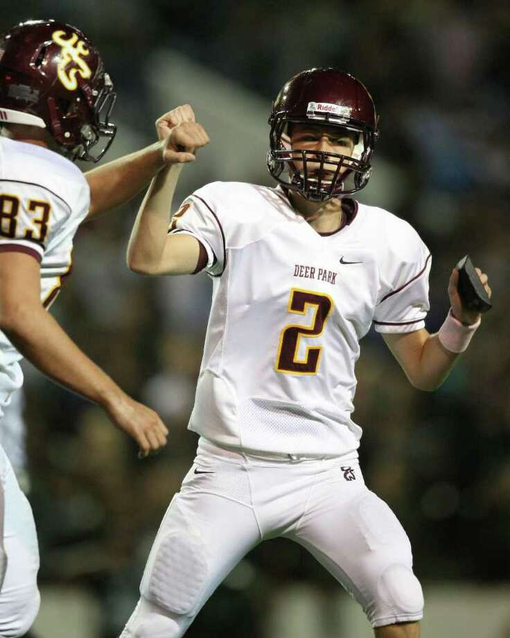 After kicking a 32-yard field goal, Deer Park's Zane Gonzalez (2) is congratulated by teammate Dakota Chandler. Photo: Eric Christian Smith, For The Chronicle