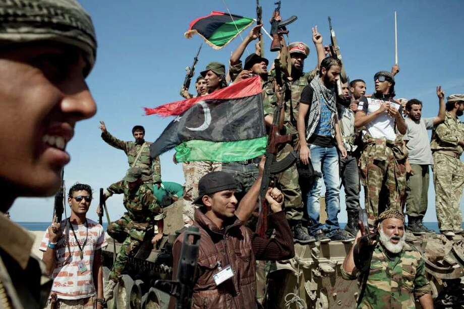 MAURICIO LIMA: NEW YORK TIMES  JOY IN LIBYA: Anti-Gadhafi fighters on Thursday celebrate the death of Moammar Gadhafi after taking control of the town of Sirte. One of the toughest tasks ahead for the transitional government will be controlling the armed fighters. Photo: MAURICIO LIMA / NYTNS