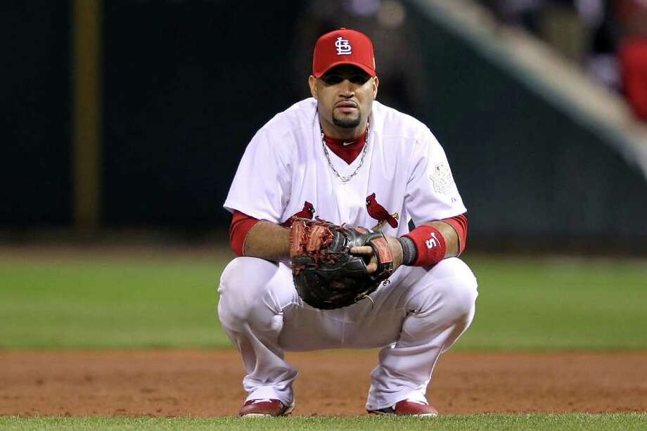 Cardinals first baseman Albert Pujols reacts after the Rangers tie the game. Photo: Jamie Squire, Getty / 2011 Getty Images