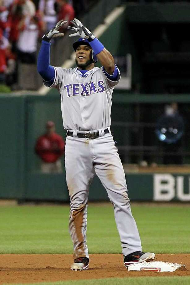 Elvis Andrus of the Rangers celebrates after hitting a single and advancing to second base on the throw in the ninth inning. Photo: Jamie Squire, Getty / 2011 Getty Images