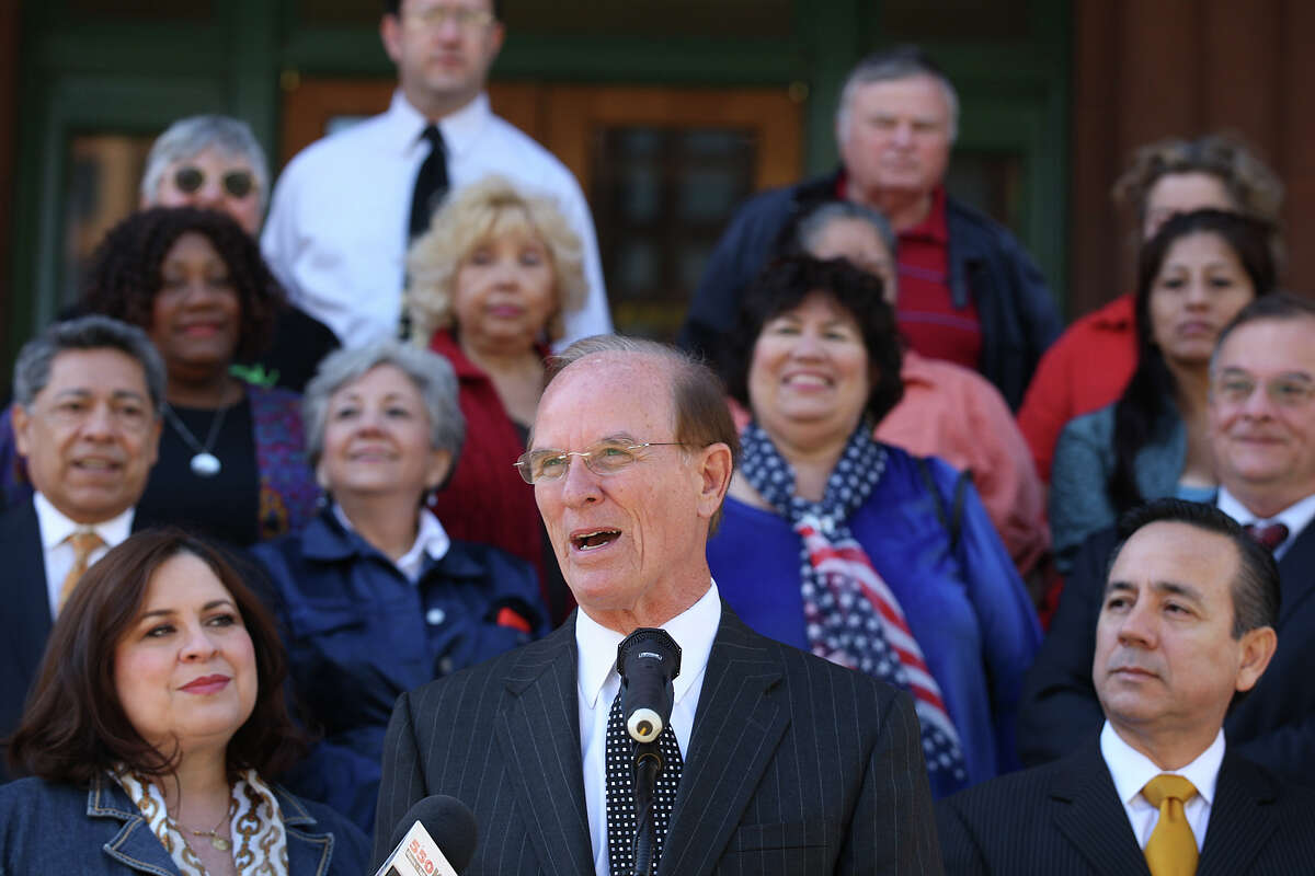 County Judge Nelson Wolff announces payment of the debt.