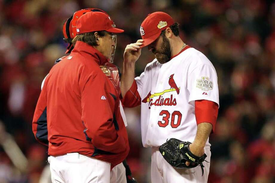 Cardinals pitcher Jason Motte reacts after allowing the tying run in the ninth inning and getting removed from the game by manager Tony La Russa. Photo: Ezra Shaw, Getty / 2011 Getty Images