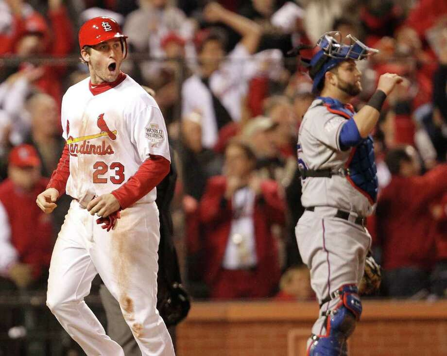 St. Louis Cardinals' David Freese (23) scores the first run of the game in front of Texas Rangers catcher Mike Napoli in the seventh inning. Photo: Ron Jenkins, McClatchy-Tribune News Service / Fort Worth Star-Telegram