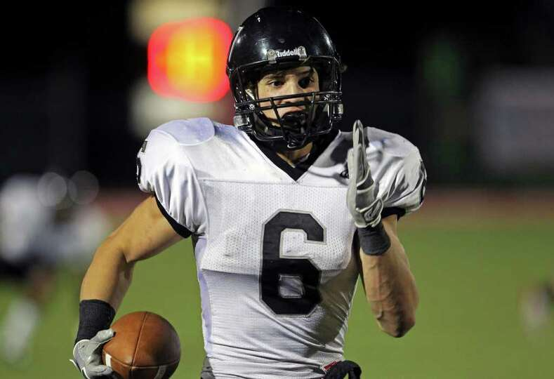 Steele defensive back Erik Huhn heads for the end zone after picking off a a pass in the fourth q