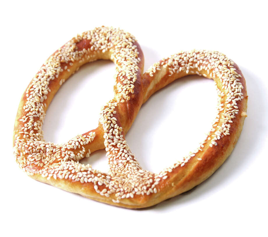 Pretzels Have you ever looked at a pretzel and been overwhelmed by the urge to pray? We haven't, but we figured it couldn't hurt to ask, since that's the whole reason the knotted bread exists in the first place. Developed by an Italian monk in 610AD, the pretzel was meant as a reward for memorizing scripture and praying. He shaped the bread to resemble the folded arms of a child engaged in prayer and called them pretiolia, which means 'little rewards'. One word of caution, however: trying to pay the guy at the pretzel stand in the mall by praying at him doesn't work all that well. We tried.