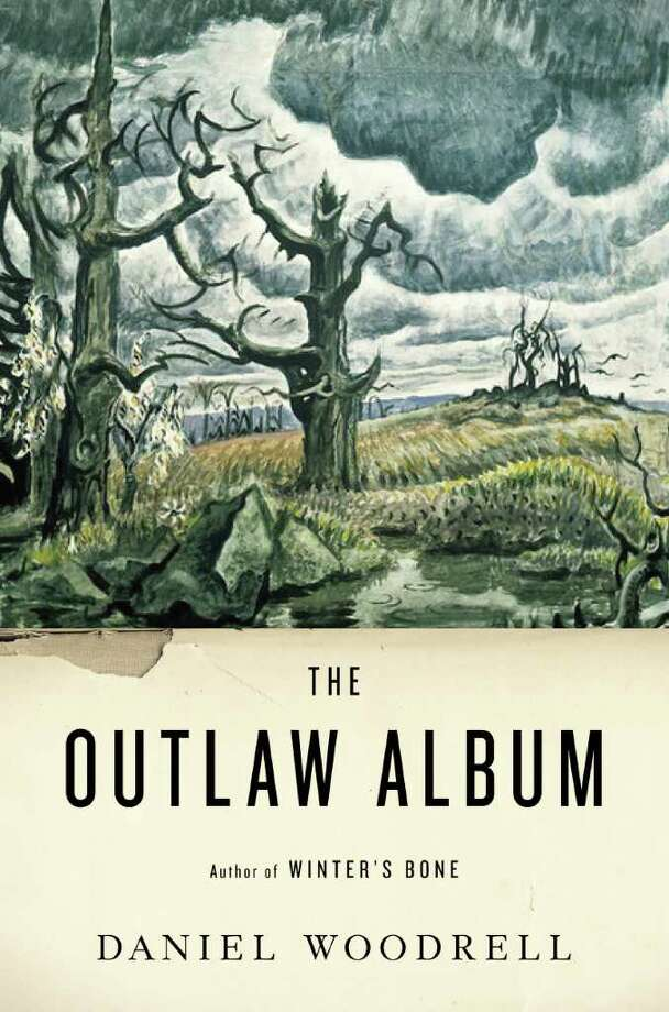 "In this book cover image released by Little, Brown and Co., ""The Outlaw Album,"" by Daniel Woodrell, is shown. (AP Photo/Little, Brown and Co.) / Little, Brown and Co."