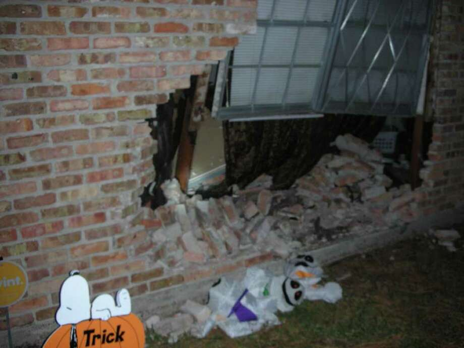 The driver of a Dodge Ram crashed into an Orange home early Friday morning. While trying to flee, he then ran into the resident's car. Photo: Courtesy Of Orange PD