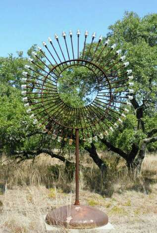 """Moon Gate"" is one of five outdoor sculptures by Texas artist Scott Sustek at the Benini Sculpture Ranch. Photo: Photo By Steve Bennett"