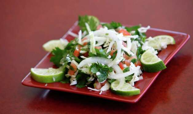 Cabbage Lime Slaw from Rosario's restaurant is a light and tasty appetizer created with no oil. Photo: WILLIAM LUTHER, SAN ANTONIO EXPRESS-NEWS / 2011 SAN ANTONIO EXPRESS-NEWS