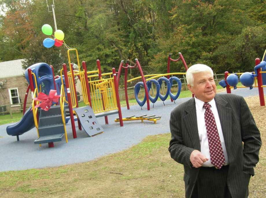 Superintendent of Schools Elliott Landon speaks at ribbon-cutting ceremony Friday afternoon for a pre-school playground at Coleytown Elementary School donated by Westport's Kiev family. When 5-year-old Chloe was injured a year ago, the family, instead of filing a lawsuit, decided to purchase age appropriate equipment for the school campus. Photo: Contributed Photo / Westport News contributed