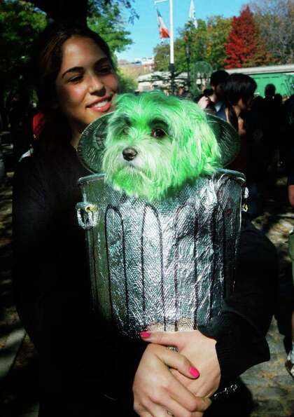 NEW YORK - OCTOBER 26:  Dog Oliver is dressed as Oscar the Grouch with owner Niki Khindri during the