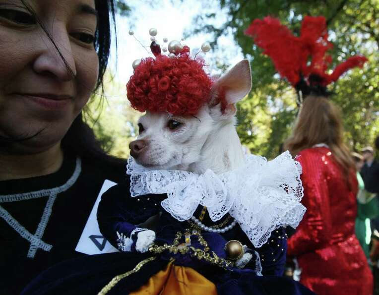 NEW YORK - OCTOBER 28:  Lisa Labrado holds her dog Chiquita as she poses as Queen Elizabeth during t