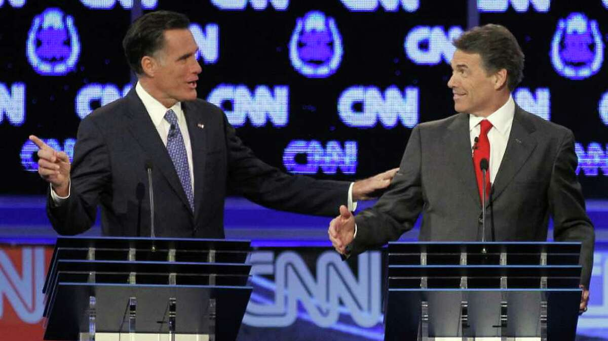Two Republican presidential hopefuls in Las Vegas: At one point ex-Massachusetts Gov. Mitt Romney (left) was ruffled by Texas Gov. Rick Perry, but in the end, the former remained the man to beat.