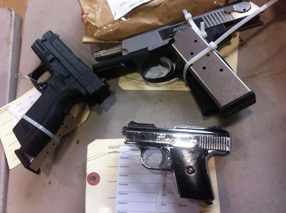 Some of the 68 guns seized during a three-month operation in White Center. Photo: Casey McNerthney/seattlepi.com