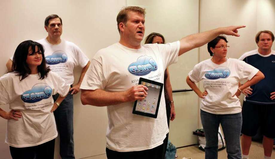 "FOR SALFIE - Ethics Follies director Lee Cusenbary (center) talks with cast and crew during a rehearsal for the musical comedy ""Cloud 9"" Monday Oct. 17 2011 at the law offices of Cox Smith Matthews Incorporated.  (PHOTO BY EDWARD A. ORNELAS/eaornelas@express-news.net) Photo: EDWARD A. ORNELAS, Eaornelas@express-news.net / © SAN ANTONIO EXPRESS-NEWS (NFS)"