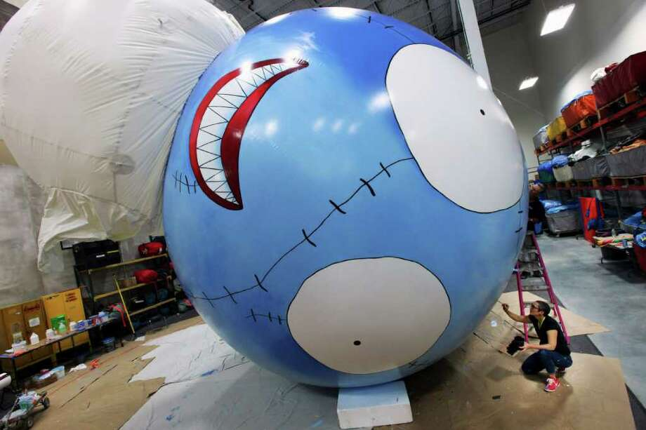RICHARD PERRY : NEW YORK TIMES AIR ART: Beth Lucas paints a balloon designed by artist and filmmaker Tim Burton for the Macy's Thanksgiving parade. Burton's contribution to the Nov. 24 parade will be a character called B. Boy (or B., for short). Photo: Richard Perry / NYTNS