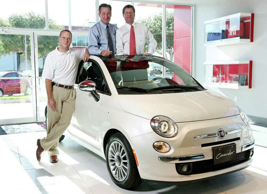 Posing with a Fiat 500c at Cavender Fiat are Nathan C. Spencer (from left), Rick Cavender and Stephen Cavender, who says he expects the brand, with its Italian styling, good fuel economy and aggressive pricing, to appeal to young buyers. Photo: EDWARD A. ORNELAS, SAN ANTONIO EXPRESS-NEWS / © SAN ANTONIO EXPRESS-NEWS (NFS)