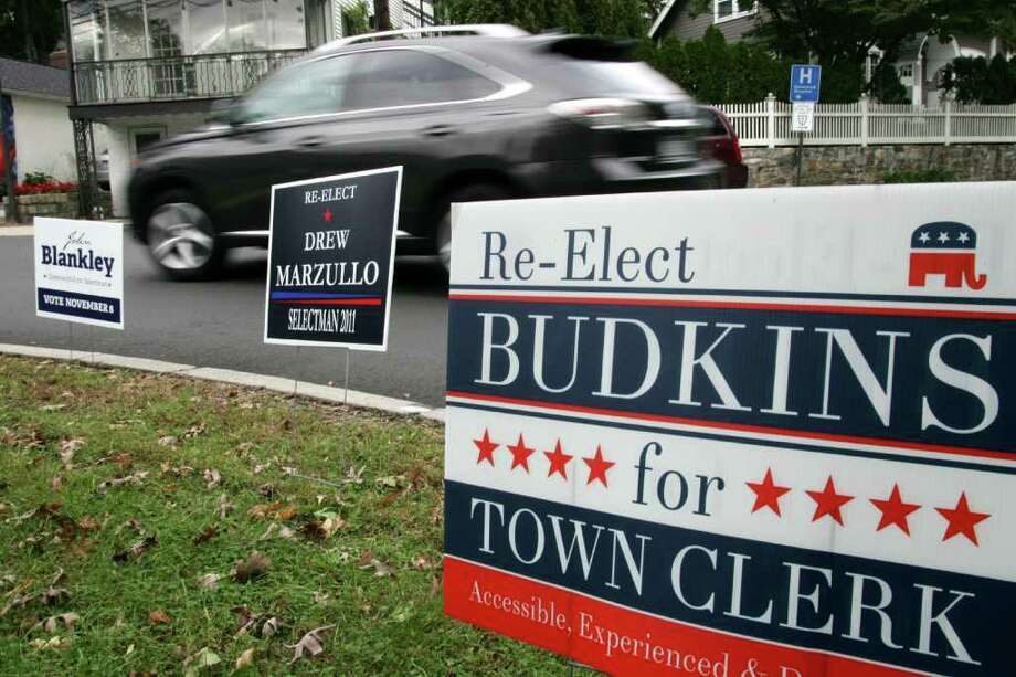 Some town residents have been calling for a ban on municipal property of campaign signs, like these seen at the Lake Avenue traffic circle Friday, Oct. 21, 2011.  the signs have been sprouting up all over Greenwich as the election draws near. Photo: David Ames / Greenwich Time