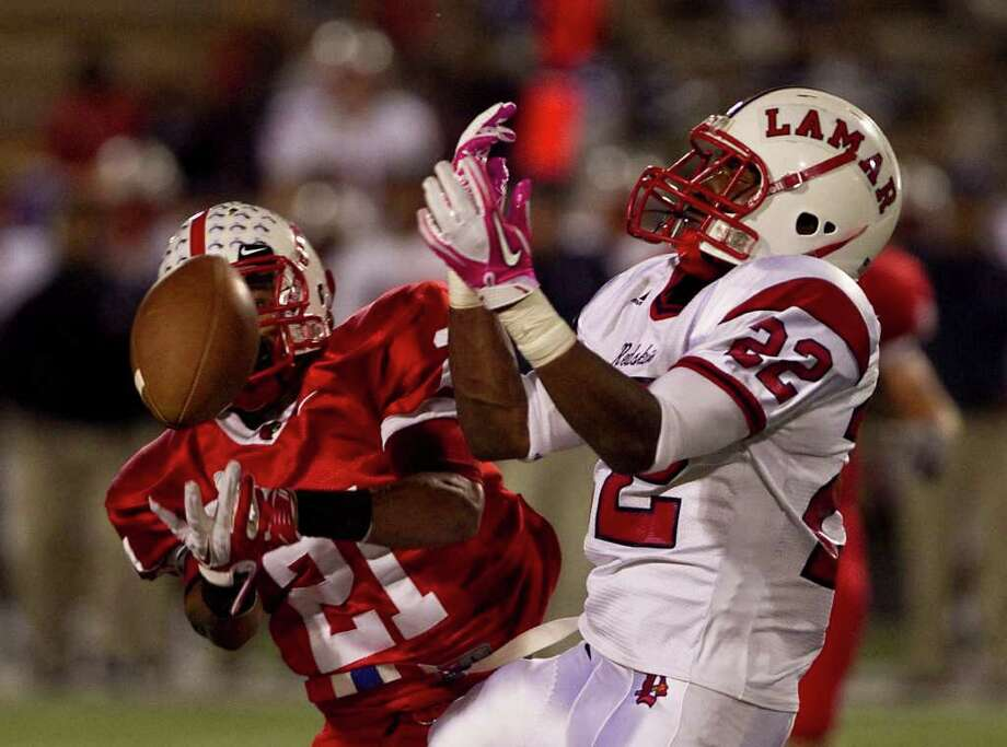 Bellaire High School's Khari Sharif (21) breaks up a pass intended for Lamar High School's Kevan Hall (22) during the first quarter of a 20-5A high school football game, Friday, Oct. 21, 2011, at Butler Stadium  in Houston. Photo: Nick De La Torre, Houston Chronicle / © 2011  Houston Chronicle