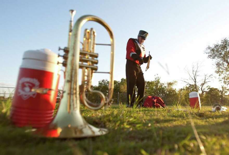 Gabe Merville, 16, of the Bellaire High School Fighting Cardinal Band, bets dressed to perform in th