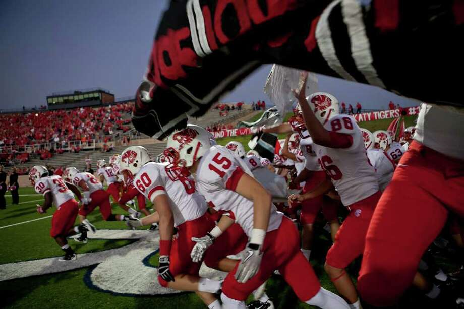 The Tigers make their way onto the field as Katy takes on Memorial Friday evening October 21, 2011 at Derrell Tully Stadium. As two of the area's top 10 teams (Katy is No. 1) will meet in the biggest 19-5A game of the year so far at Memorial's home-coming game.    Nathan Lindstrom/Special to the Chronicle  ©2011 Nathan Lindstrom Photo: Nathan Lindstrom, Freelance / ©2011 Nathan Lindstrom