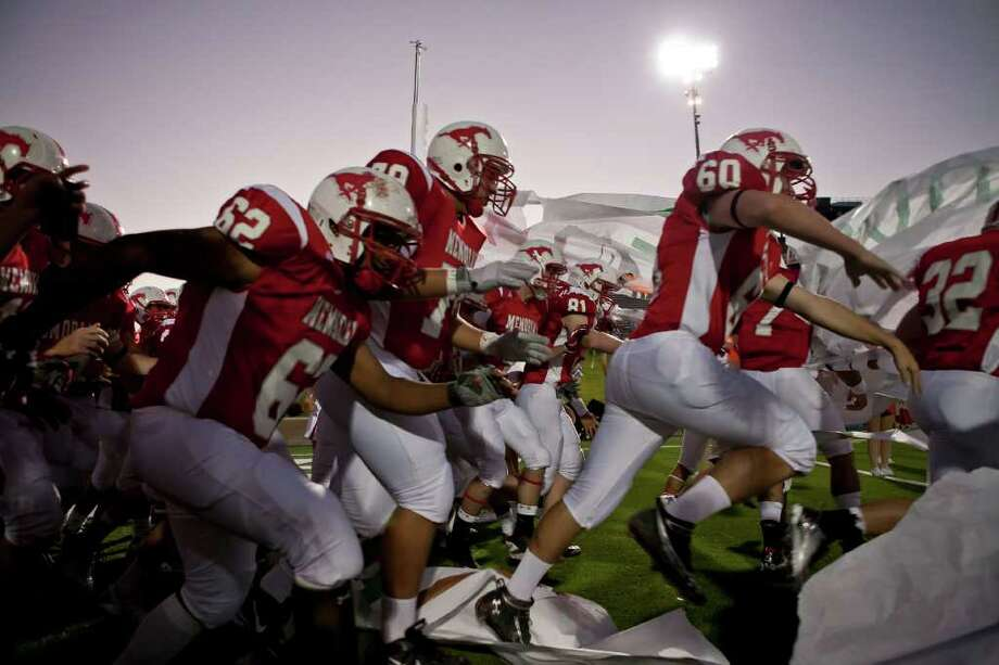 The Mustangs make their entrance onto the field as Memorial takes on Katy Friday evening October 21, 2011 at Derrell Tully Stadium. As two of the area's top 10 teams (Katy is No. 1) will meet in the biggest 19-5A game of the year so far at Memorial's home-coming game.    Nathan Lindstrom/Special to the Chronicle  ©2011 Nathan Lindstrom Photo: Nathan Lindstrom, Freelance / ©2011 Nathan Lindstrom