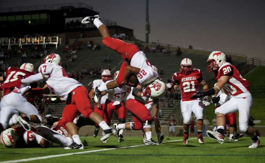 Tigers running back Rodney Anderson (26) flips into the endzone for Katy's first touchdown against Memorial Friday evening October 21, 2011 at Derrell Tully Stadium. As two of the area's top 10 teams (Katy is No. 1) will meet in the biggest 19-5A game of the year so far at Memorial's home-coming game.    Nathan Lindstrom/Special to the Chronicle  ©2011 Nathan Lindstrom Photo: Nathan Lindstrom, Freelance / ©2011 Nathan Lindstrom