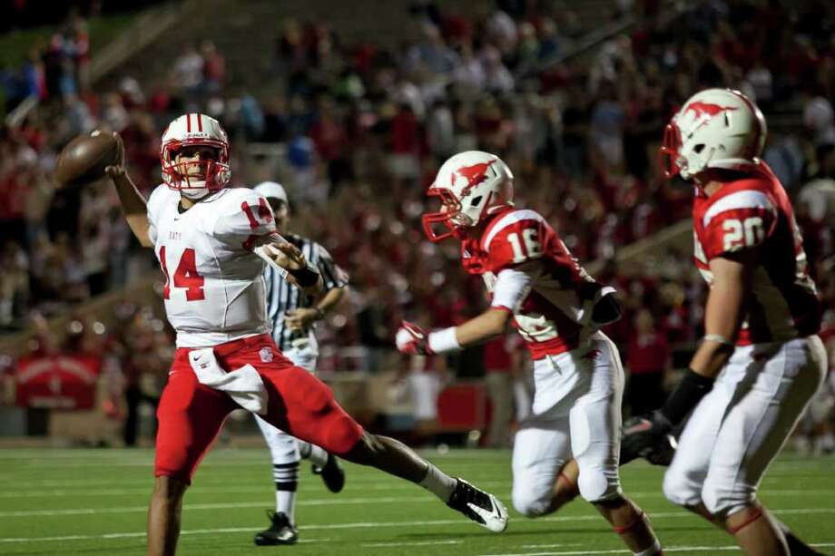 Tigers quarterback Brooks Haack (14) makes a pass to tight end Stein Spiller for Katy's second touchdown against Memorial Friday evening October 21, 2011 at Derrell Tully Stadium. As two of the area's top 10 teams (Katy is No. 1) will meet in the biggest 19-5A game of the year so far at Memorial's home-coming game. 