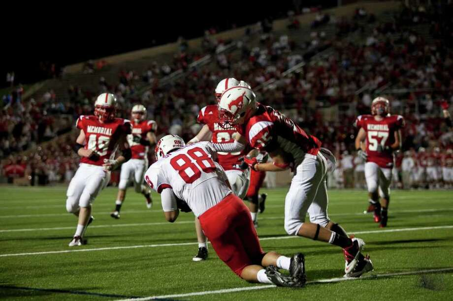 Tigers tight end Stein Spiller (88) makes a reception for Katy's second touchdown against Memorial Friday evening October 21, 2011 at Derrell Tully Stadium. As two of the area's top 10 teams (Katy is No. 1) will meet in the biggest 19-5A game of the year so far at Memorial's home-coming game. 