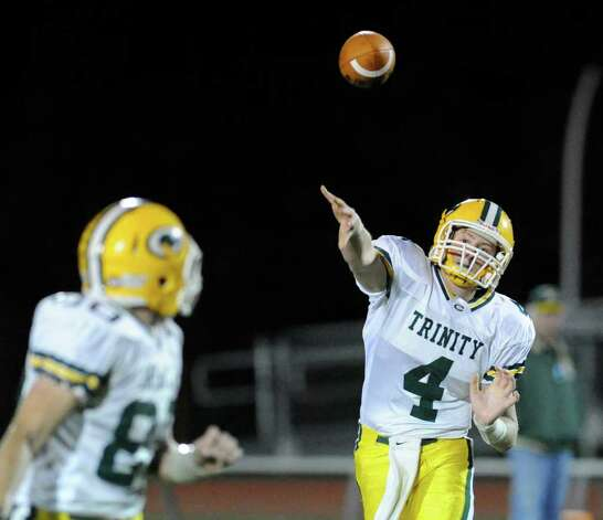 Trinity Catholic QB Danny O'Leary, # 4 throws to a teammate during high school football game between Fairfield Warde High School and Trinity Catholic High School, at Fairfield Warde, Friday night, Oct. 21, 2011. Photo: Bob Luckey / Greenwich Time