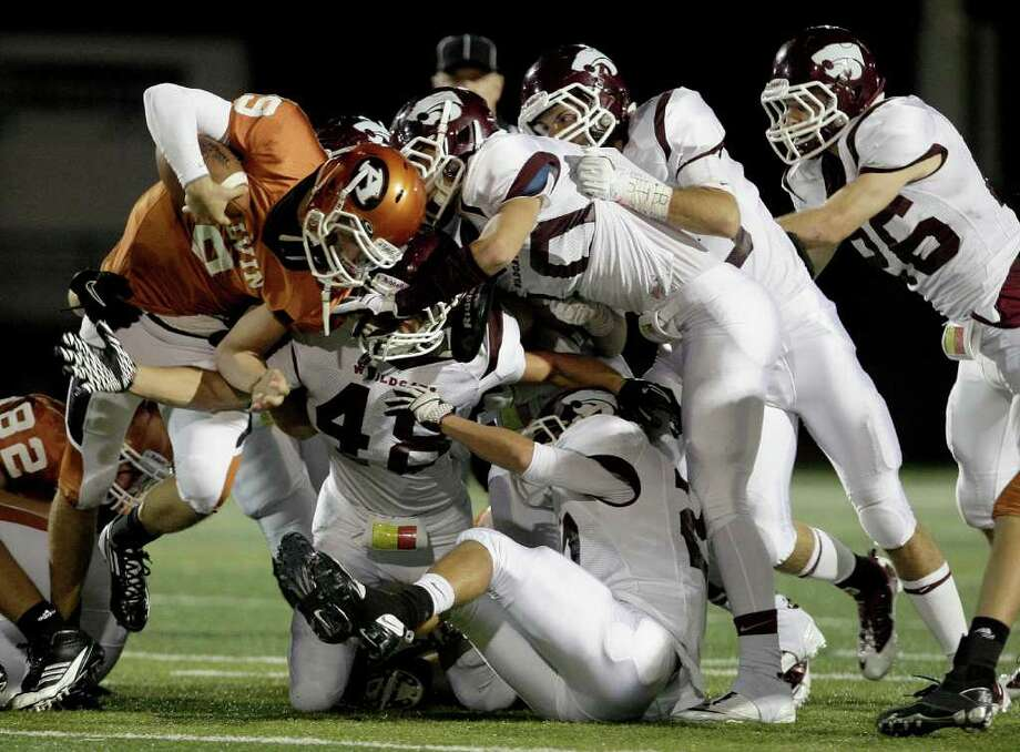 Quarterback Josh Ceyanes-Erwin #9 of the Alvin Yellowjackets is ganged tackled by linebacker Kurtis Lester #48 and the Clear Creek Wildcats defense in a high school football game at Alvin Memorial Stadium in Alvin, Texas. For the Chronicle: Thomas B. Shea Photo: For The Chronicle: Thomas B. She
