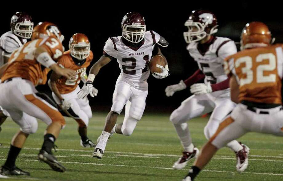 Running back Marcus Nelson #21 of the Clear Creek Wildcats runs through the Alvin Yellowjackets defense in a high school football game at Alvin Memorial Stadium in Alvin, Texas. For the Chronicle: Thomas B. Shea Photo: For The Chronicle: Thomas B. She