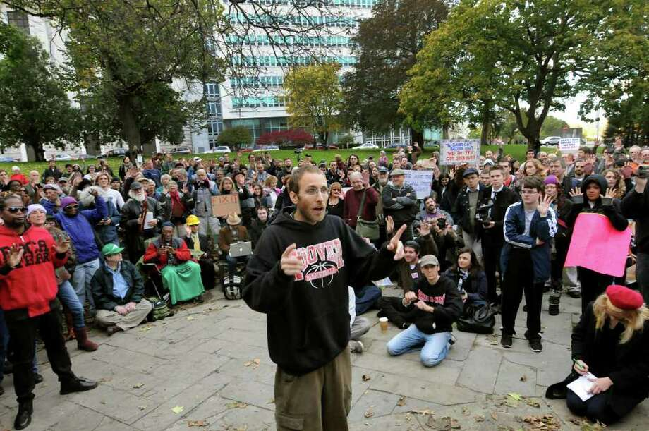 Mike Rancourt of Troy, a facilitator for the general assembly, center, speaks during Occupy Albany on Friday, Oct. 21, 2011, at Academy Park in Albany, N.Y. (Cindy Schultz / Times Union) Photo: Cindy Schultz / 00015065A
