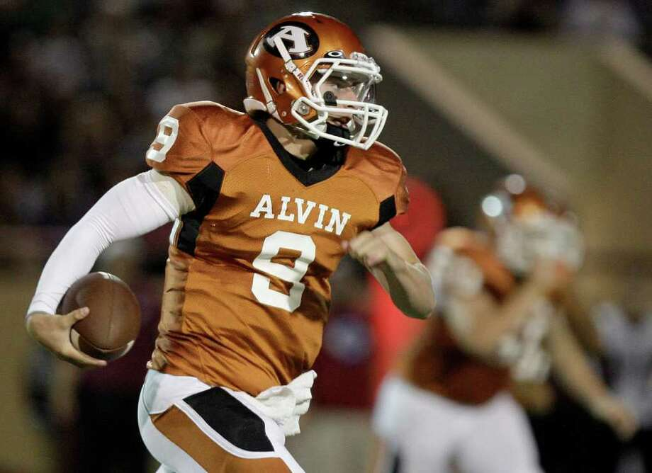 Quarterback Josh Ceyanes-Erwin #9 of the Alvin Yellowjackets rushes the ball against the Clear Creek Wildcats defense in a high school football game at Alvin Memorial Stadium in Alvin, Texas. For the Chronicle: Thomas B. Shea Photo: For The Chronicle: Thomas B. She