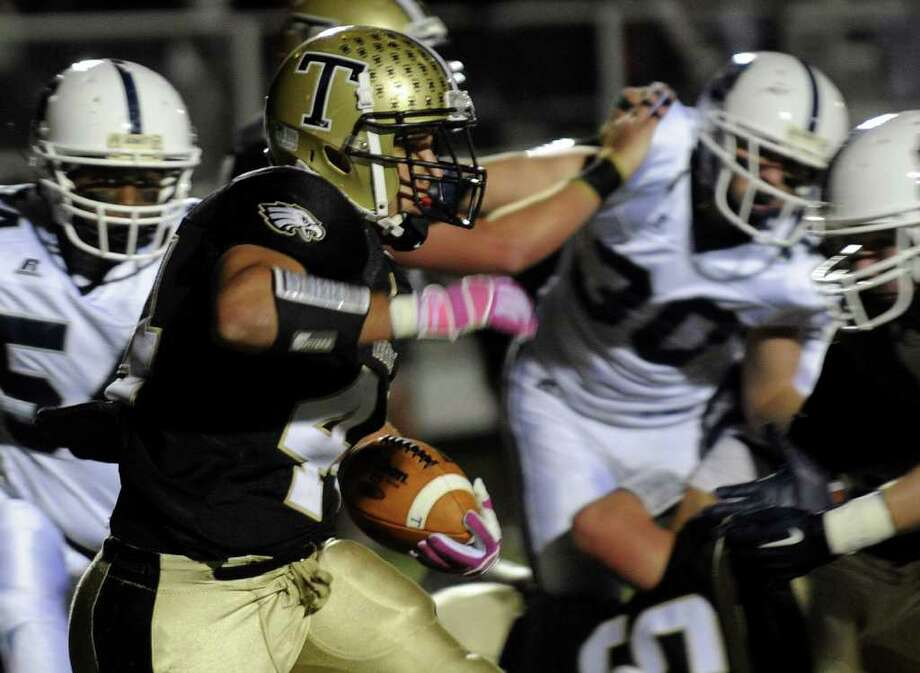 Trumbull's #44 Don Cherry carries the ball, during boys football action against Staples in Trumbull, Conn. on Friday October 21, 2011. Photo: Christian Abraham / Connecticut Post