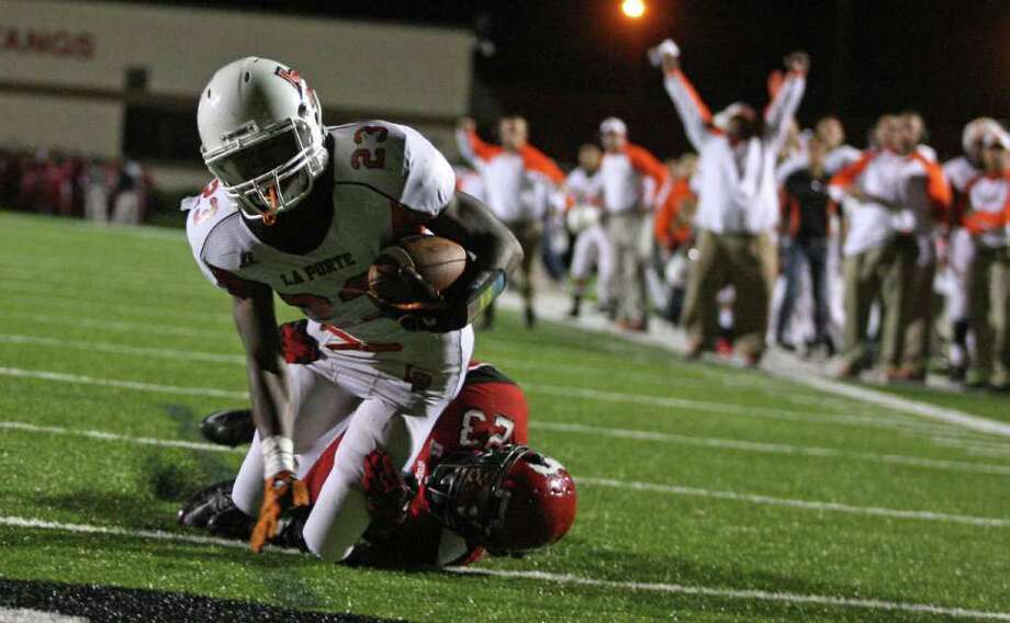 La Porte's Johnathan Lewis falls into the end zone for a touchdown past North Shore's Jacoby Walker during the first half of a high school football game, Friday, October 21, 2011 at Galena Park Stadium in Houston. Photo: Eric Christian Smith, For The Chronicle
