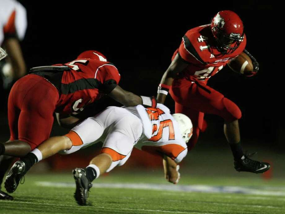 North Shore's Davonte Milton (41) leaps past la Porte's Cameron Whilley (45) as teammate Rodric Simmons provides a block during the first half of a high school football game, Friday, October 21, 2011 at Galena Park Stadium in Houston. Photo: Eric Christian Smith, For The Chronicle