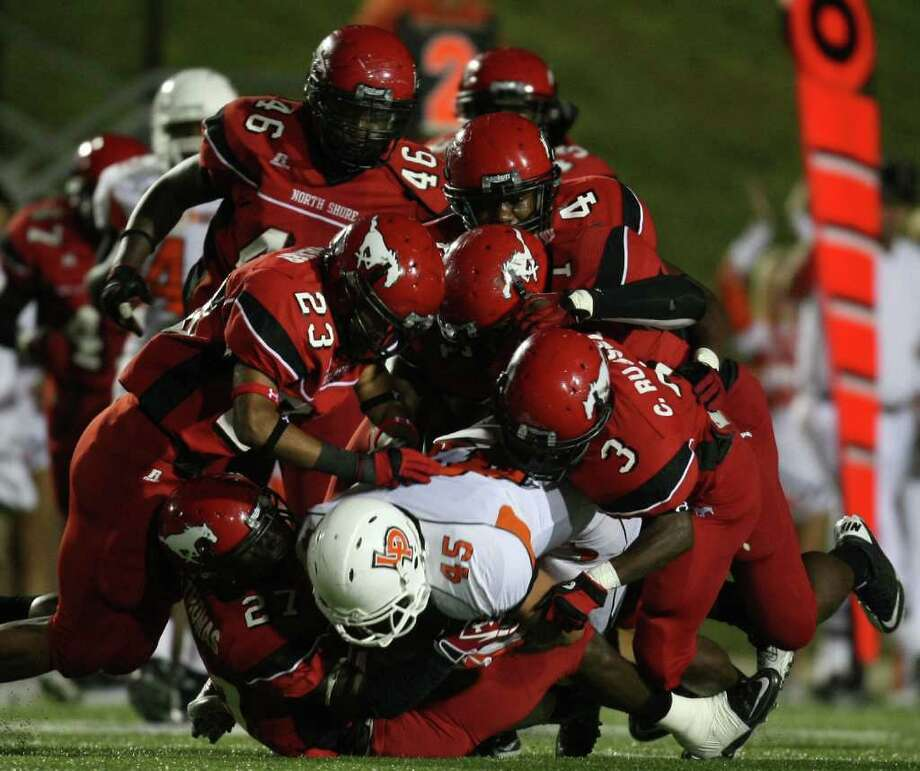 La Porte's Cameron Whilley (45) is brought down by North Shore's Earnest Thomas (27) and a wall of Mustang defenders during the first half of a high school football game, Friday, October 21, 2011 at Galena Park Stadium in Houston. Photo: Eric Christian Smith, For The Chronicle