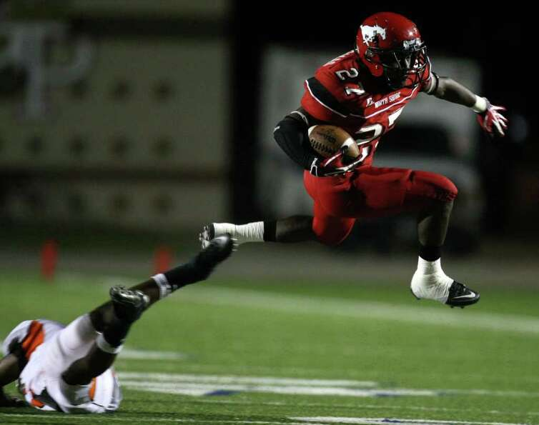 On fourth-and-five, North Shore's Earnest Thomas (27) leaps past a La Porte defender for a first dow