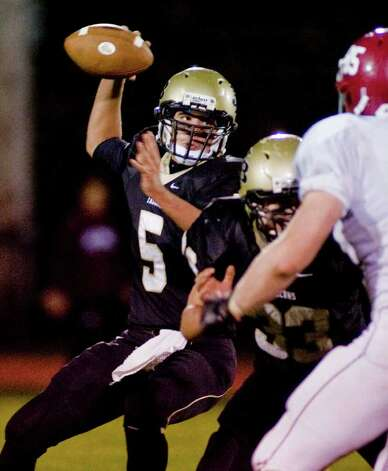Joel Barlow quarterback Cooper Brown prepares to throw a pass against Bethel High School during a football game at Barlow. Friday, Oct. 21, 2011 Photo: Scott Mullin / The News-Times Freelance